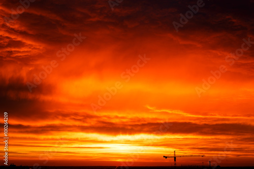 Foto op Canvas Baksteen Red sunset in blue cumulus clouds