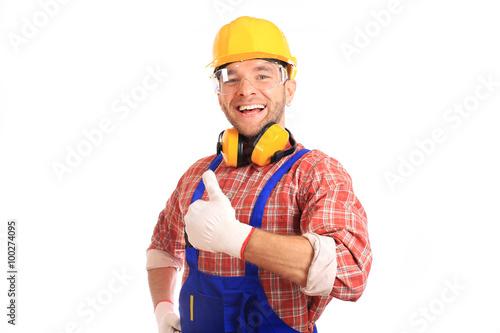 Fotografie, Obraz  Stavitel ve žluté helmě, ochranné brýle a pracovních oděvů