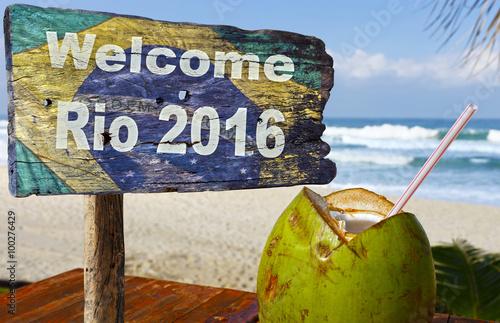 Welcome sign to Rio de Janeiro, near a coconut Poster