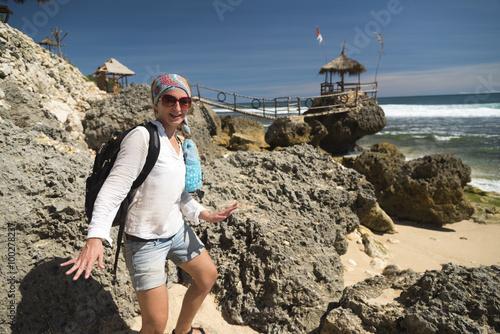 White caucasian girl having fun at the gazebo near ocean Canvas Print