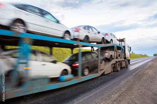 Photo  transportation of car on semi-trailer