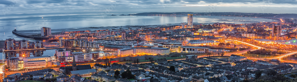 Fototapeta An evening view of Swansea centre and the Bay area taken from Kilvey Hill January 2016