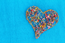 Heart Made Of Colorful Beads On Blue Background With Copy Space