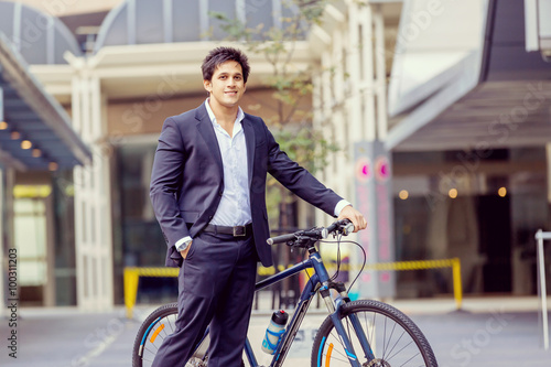 Deurstickers Fiets Successful businessman with bicycle