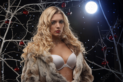 Canvas Prints Dragons Sensual woman posing in blue light with apple