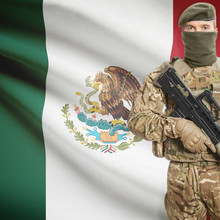 Soldier With Machine Gun And Flag On Background - Mexico