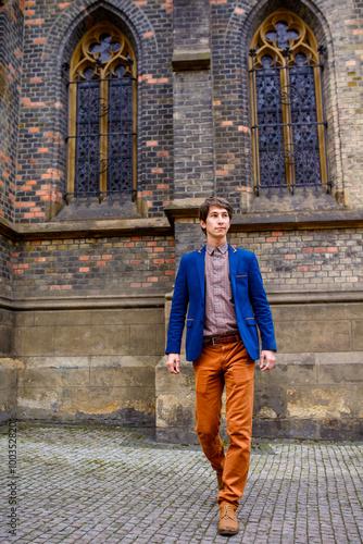 beige trousers blue blazer
