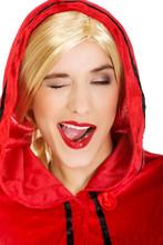 Woman As A Little Red Riding Hood Blinks Eye.