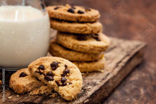 Fotografie, Obraz  Chocolate Chip Cookie with milk bottle