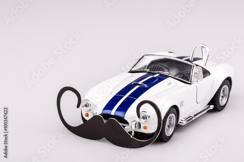 Photo  bautiful blue and white car, roadster with mustache