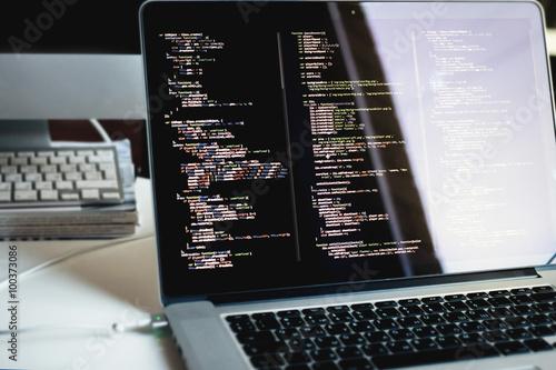 Fotografie, Obraz  Js kód na obrazovce přenosného počítače, vývoj webových aplikací