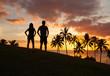 Romantic couple enjoying beautiful sunset in Hawaii