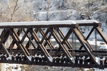 Snow Covered Wooden Railway Bridge Over The Animas River