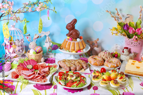 traditional easter breakfast on festive table - 100402892