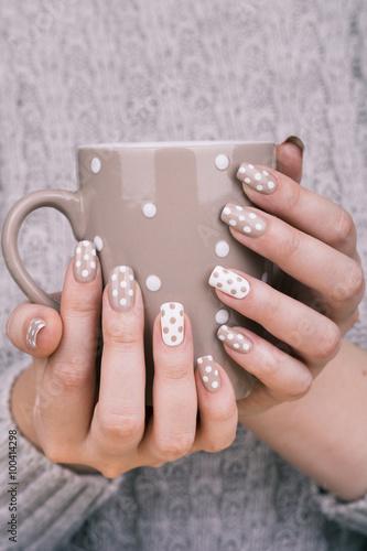Fotografie, Tablou  Manicure - Beauty treatment photo of nice manicured woman fingernails holding cup