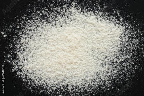 white flour on black background - free space for text Fototapeta