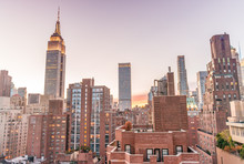 New York Skyline From Rooftop. Sunset Over Manhattan