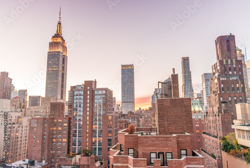 New York skyline from rooftop. Sunset over Manhattan