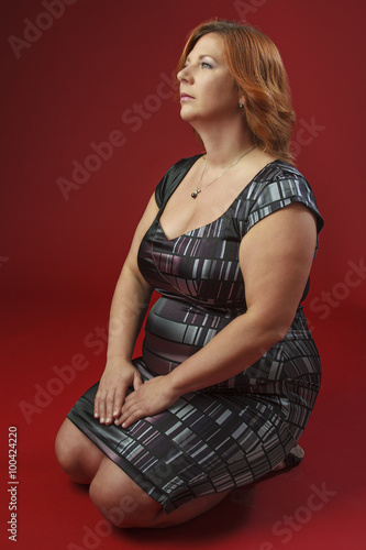 Fotografia  Kneeling woman