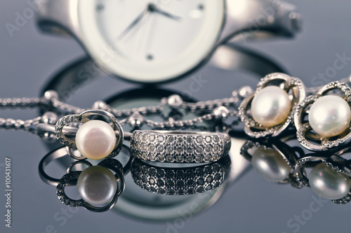 silver jewelry with pearls and elegant women's watches