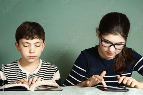 Fotografía  boy read book  girl  play tablet  computer games