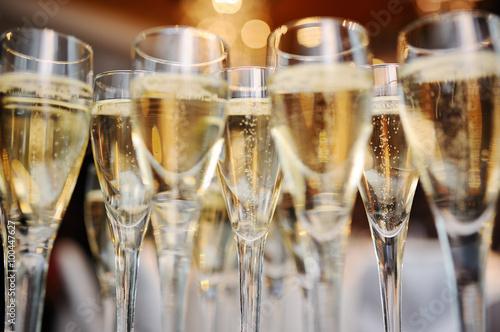 Fotografie, Obraz  champagne glasses on a background of lights