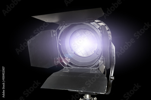 Valokuva  Spotlight fixture glowing used in film and theater productions  isolated on blac