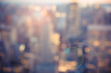 Fototapeta City - Defocused blur across urban buildings in New York City