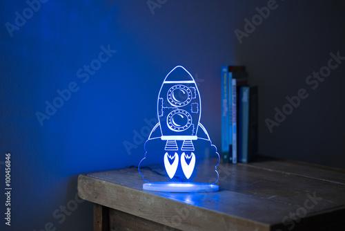 Blue Illuminated Crystal Desk Lamp with Rocketship Imprint On Si