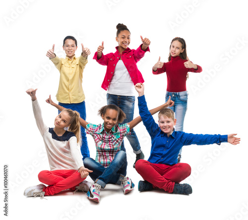 Fototapeta teenagers sitting and standing with thumbs up obraz na płótnie