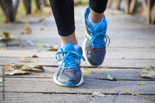 Running feet of young woman closeup on shoe
