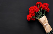Still Life Of Several Red Carnations On Black Background