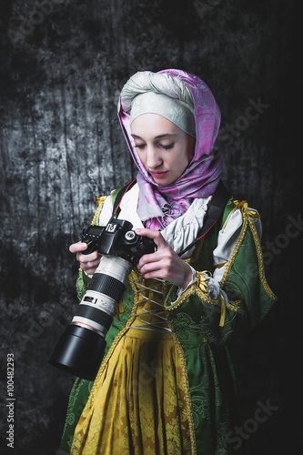 Medieval woman holds SLR camera Wallpaper Mural