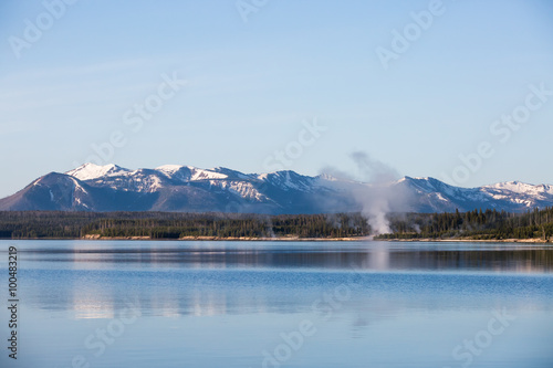 Fotografiet  Lake showing the sky with clouds and reflections on mountains and clouds in the