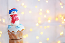 Christmas Cupcake With Lights On Background