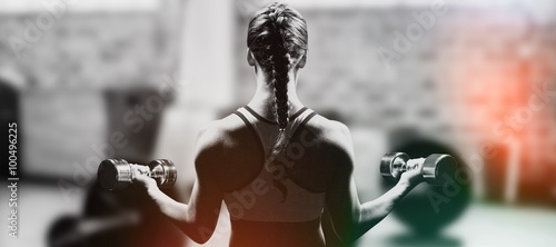 Fotografie, Obraz  Braided hair woman lifting dumbbell