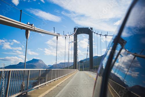 Photo  Beautiful vibrant picture of norwegian atlantic road, with bridge, road, fjord,