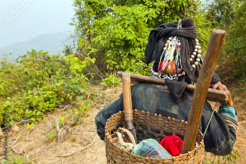 Fotografie, Obraz  Akha villager carry things on her back in mountain, Laos
