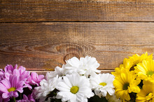Pink, White And Yellow Oxeye Daisy Flowers Bouquet On Wooden Background.