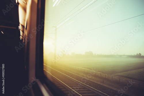 Spoed Foto op Canvas Grijze traf. Blurred vintage filtered countryside view by a train window - tr