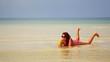 Woman sunbathing crystal water drinking coconut enjoying vacation, cambodia