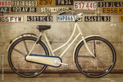 Foto op Plexiglas Retro Vintage lady bicycle in an old factory