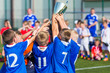 Young Sport Players Holding Trophy. Boys Celebrating Soccer Championship