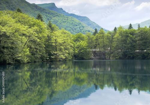 Fotobehang Bergen The picturesque Blue lake in Kabardino-Balkaria.Spring.