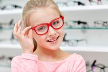 Little Girl In Glasses At Optics Store