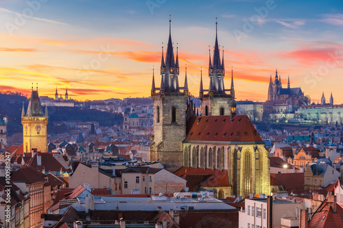 Obraz Aerial view over Church of Our Lady before Tyn, Old Town and Prague Castle at sunset in Prague, Czech Republic  - fototapety do salonu
