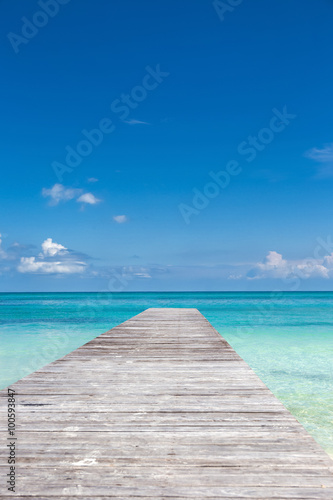 Wooden pier on tropical beach