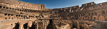 Colosseum In Rome, Italy, Blurred On Face Of People,panorama Photo.