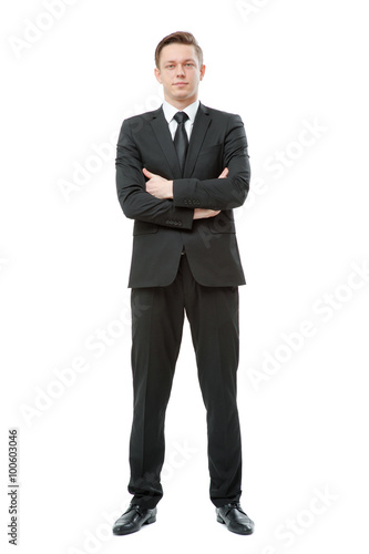 Fotografie, Obraz  Young businessman in suit and tie keeping arms crossed