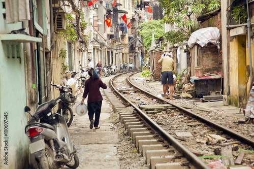 train passing through streets of hanoi slums, vietnam